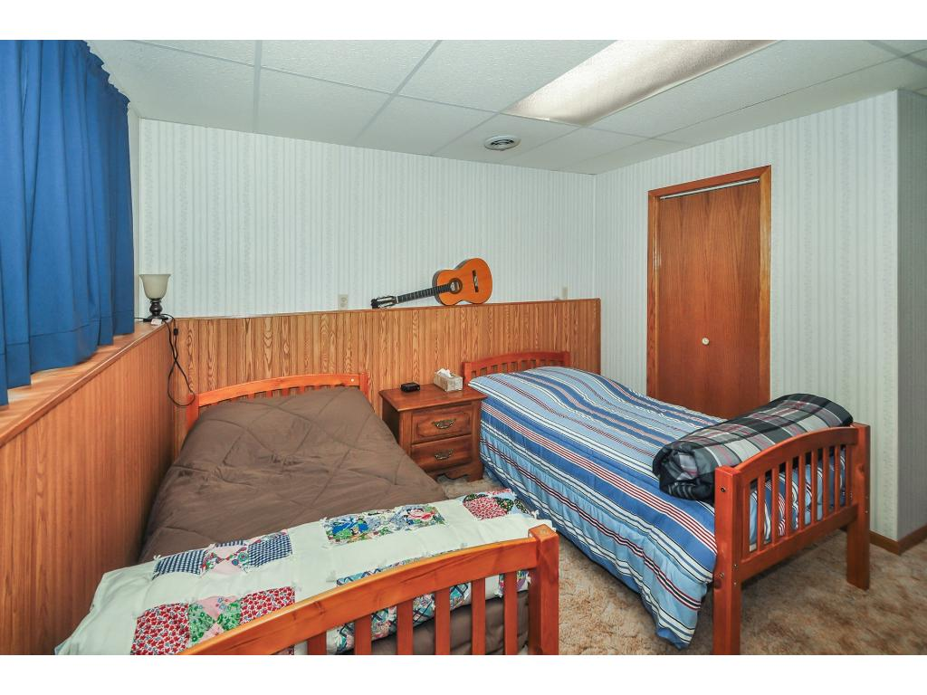 This bedroom in the lower level is currently set up for visiting guest, but has more than enough room for a bedroom set.