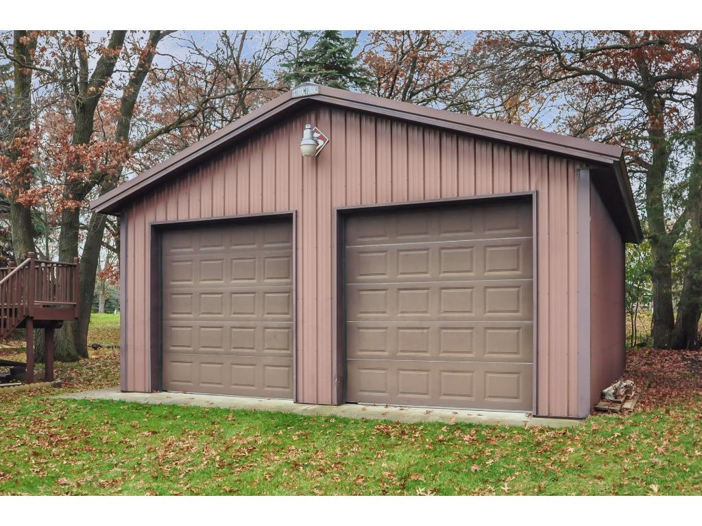 This detached garage/pole shed is 24'x27' with 10' side walls with a concrete floor. Lots of possibilities.