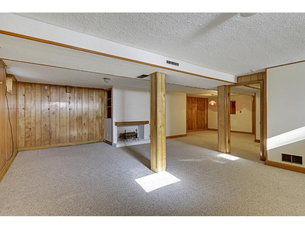 Lower level family room has lots of floor space for multiple purposes.