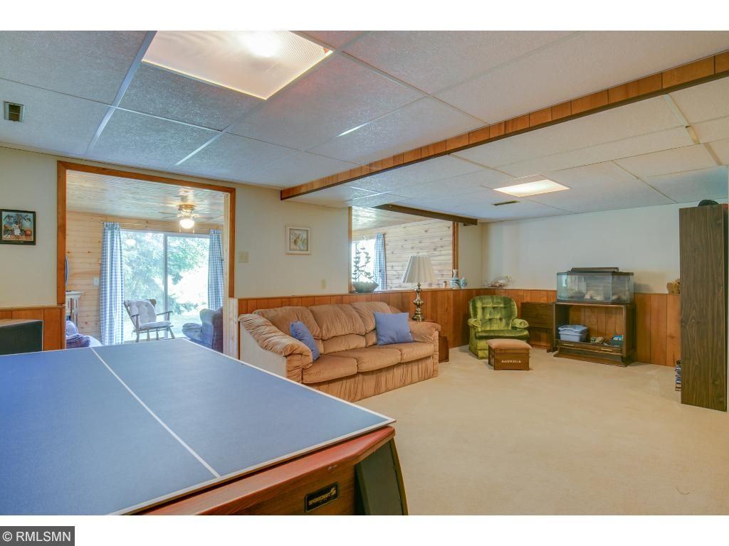 The lower level has a newer addition that walks out to the backyard, two bedrooms, a 3/4 bath and a large family room.