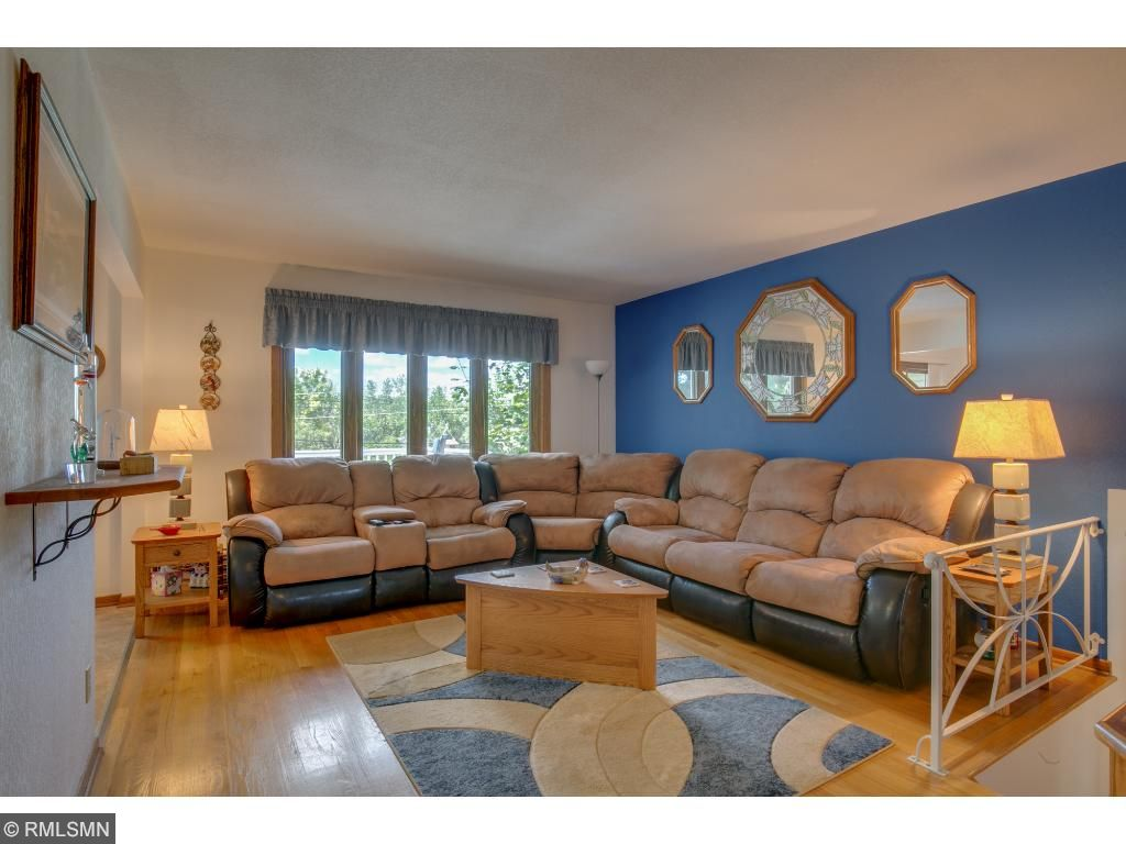 The main level living room has hardwood floors and large picture windows.