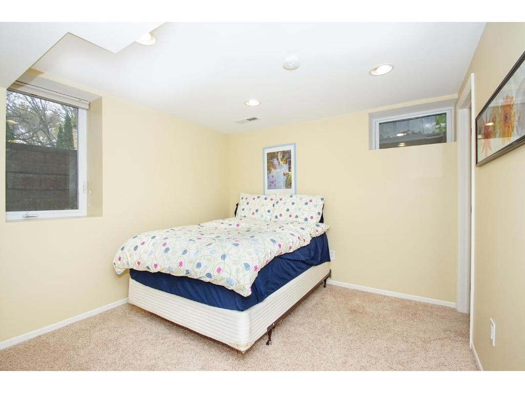Lower level bedroom suite with attached bathroom. Perfect for guests!