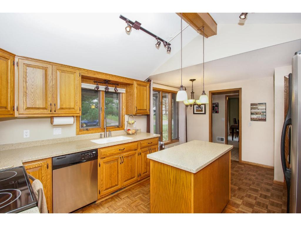 The kitchen addition is newer to the home and features a stunning vaulted ceiling!