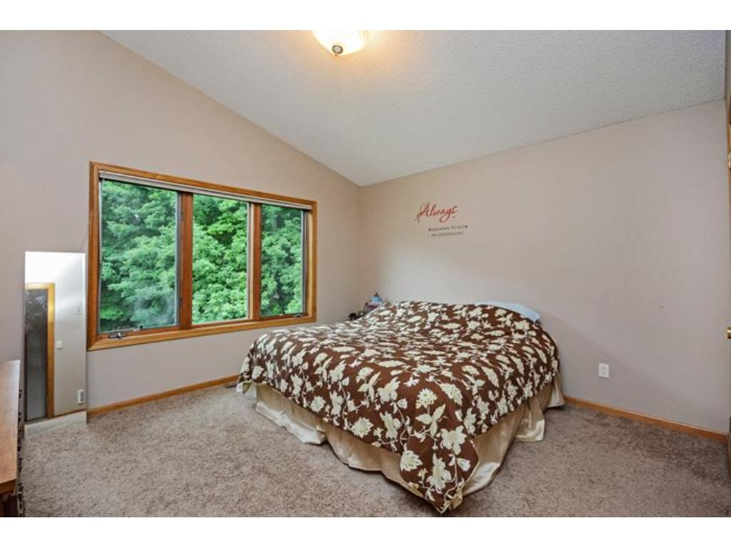 The master bedroom is on the upper level.  No worries about a king sized bed- there is plenty of room here.  Enjoy your private 3/4 master bath.  Large closet too!