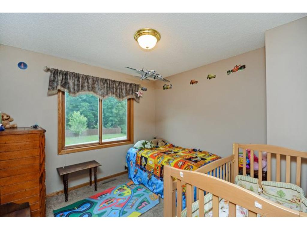 One of the upper level bedrooms.  Lots of room for furniture, toys or any other treasures your have!