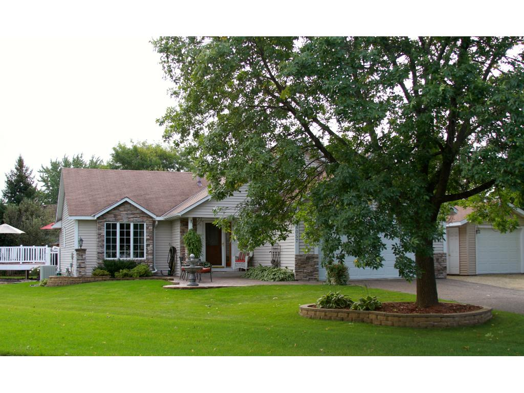 Must see home on a cul-de-sac with large yard, beautiful landscaping, paver patio and stone accents on the front of home