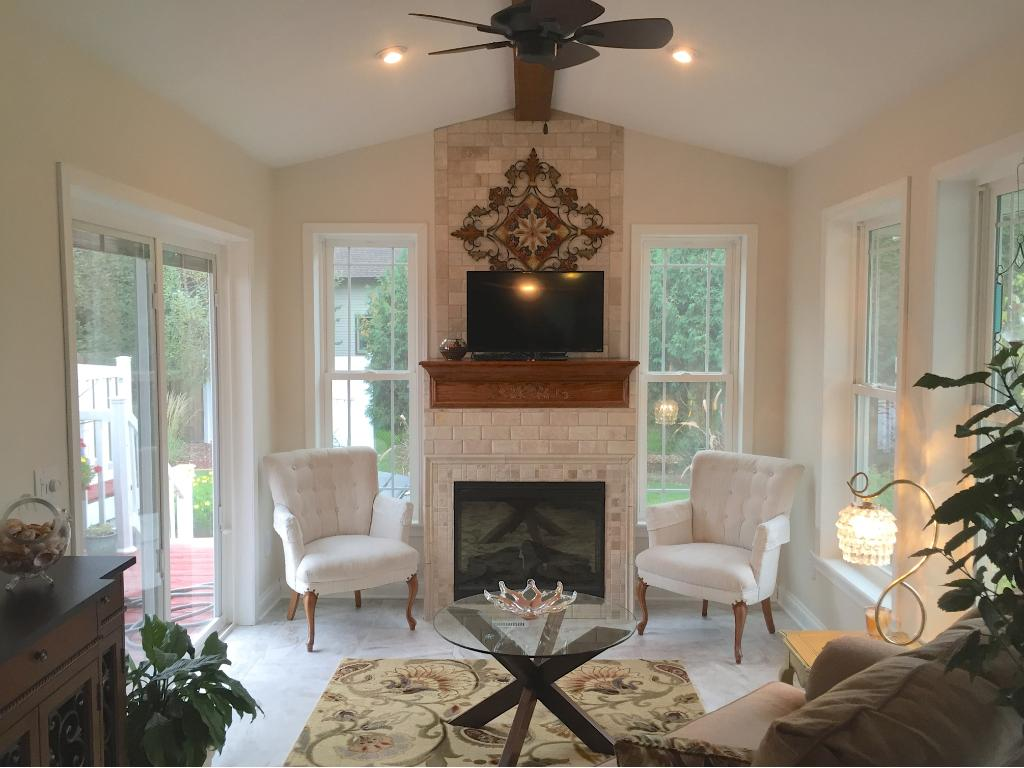 Newly added sunroom with Heatilator fireplace, porcelain tile and stone accents