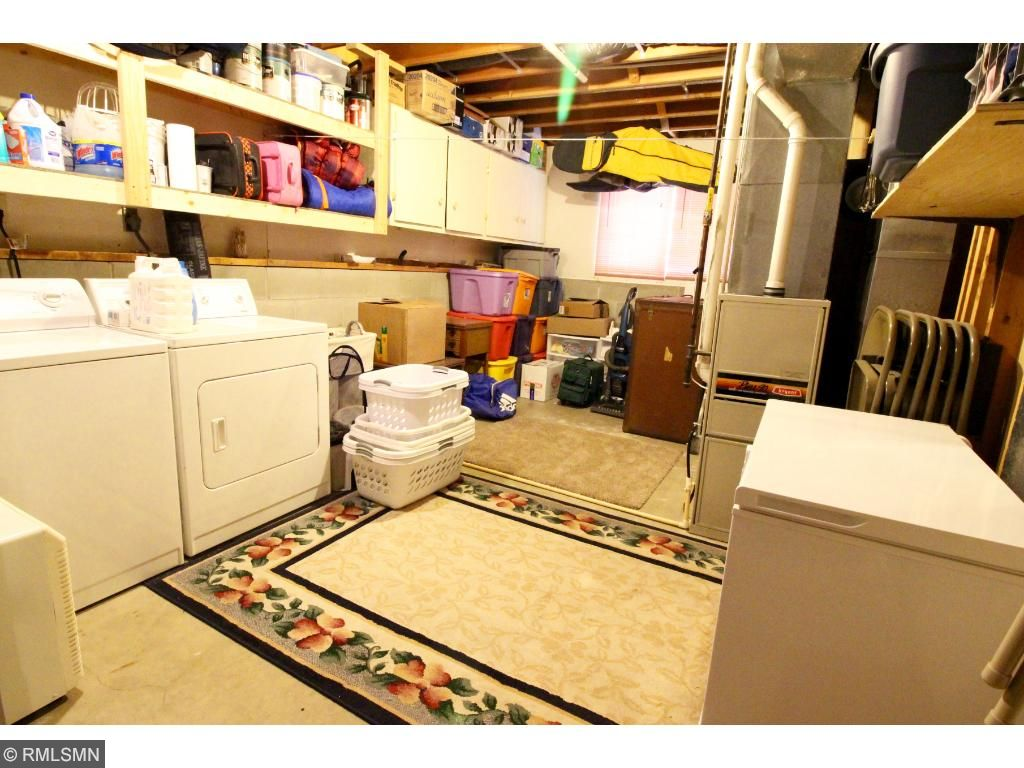 The lower level utility room is enormous and provides tons of storage!