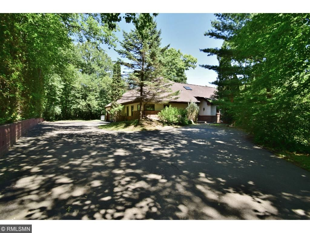 Welcome Home to This Exceptionally Private Oasis on Bogen Pond!