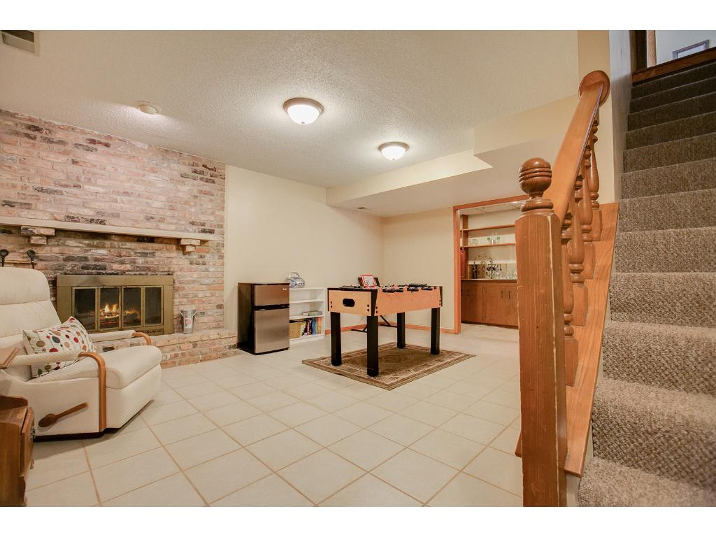 The lower level Amusement room is attached to the bar area in the back. Features include tile floors and wood burning fireplace.