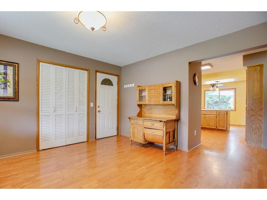 You enter the home from the front, into the living room with adjacent door to the two car garage.