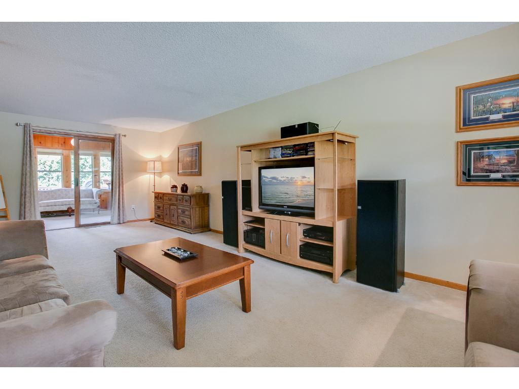 This family room connects to the cozy sunroom near the back of the house.