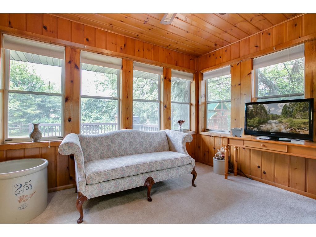 Cozy four season sunroom is perfect for relaxing and can be closed off from the rest of the home.