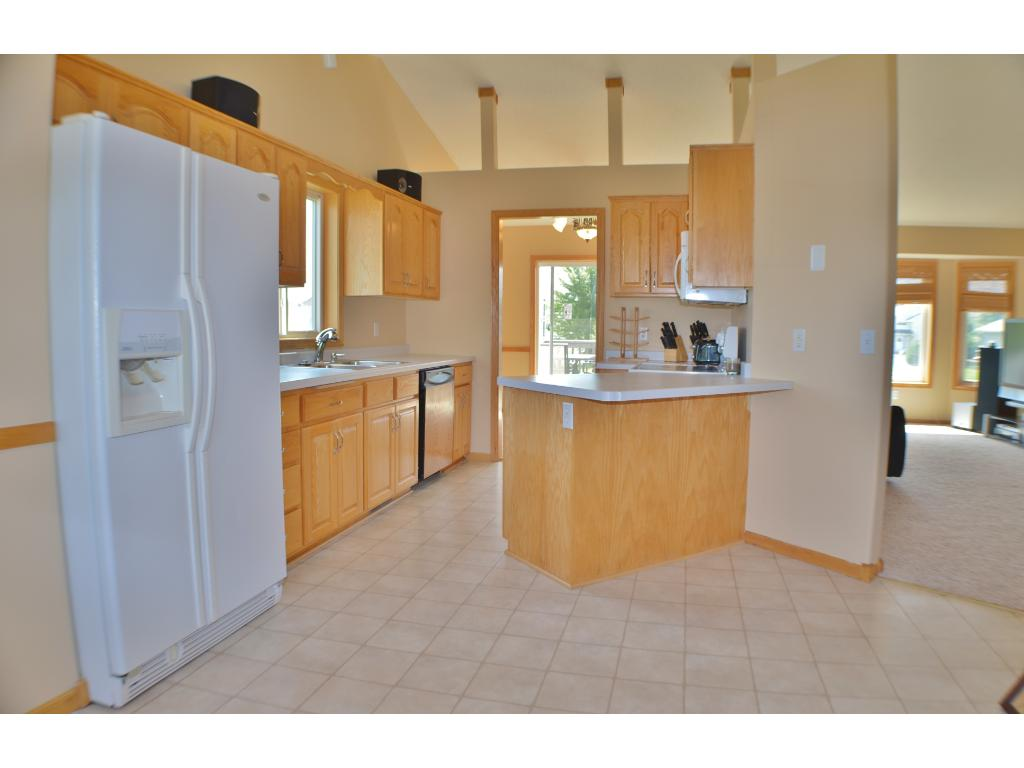 A kitchen with room to move as you cook and ample amounts of storage for all your goods.
