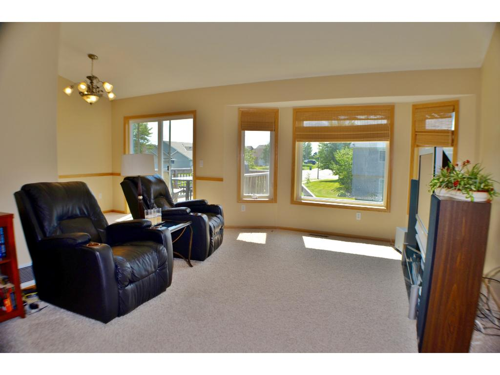 Living room on the upper level has a large bay window and vaulted ceilings giving you lots of natural light and an open, airy space.