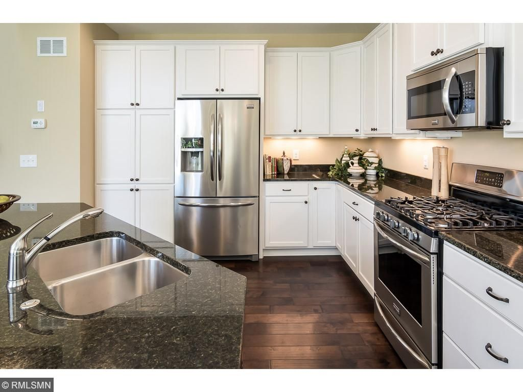 Gourmet kitchen with granite counter tops, stainless steel appliances, pre-finished wood floor, enameled cabinets and much more!