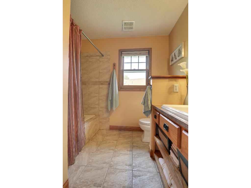 Master bath has great tile detail and an updated vanity.