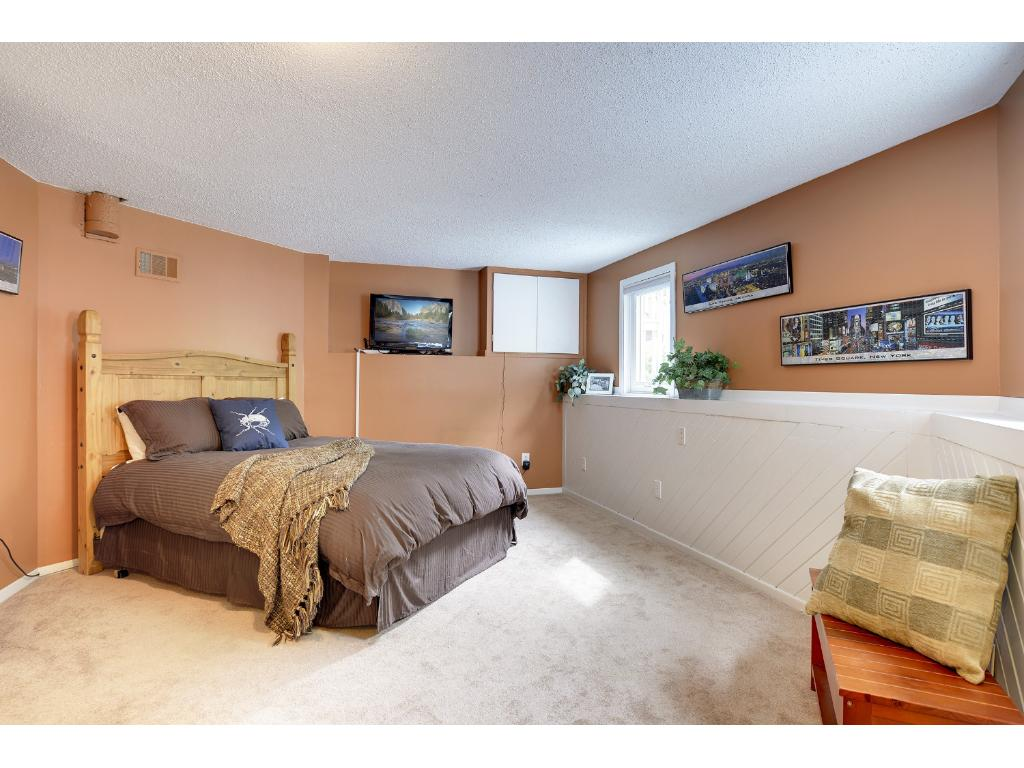 Lower level 4th bedroom.  Half bath is just outside as well as laundry/utility room.