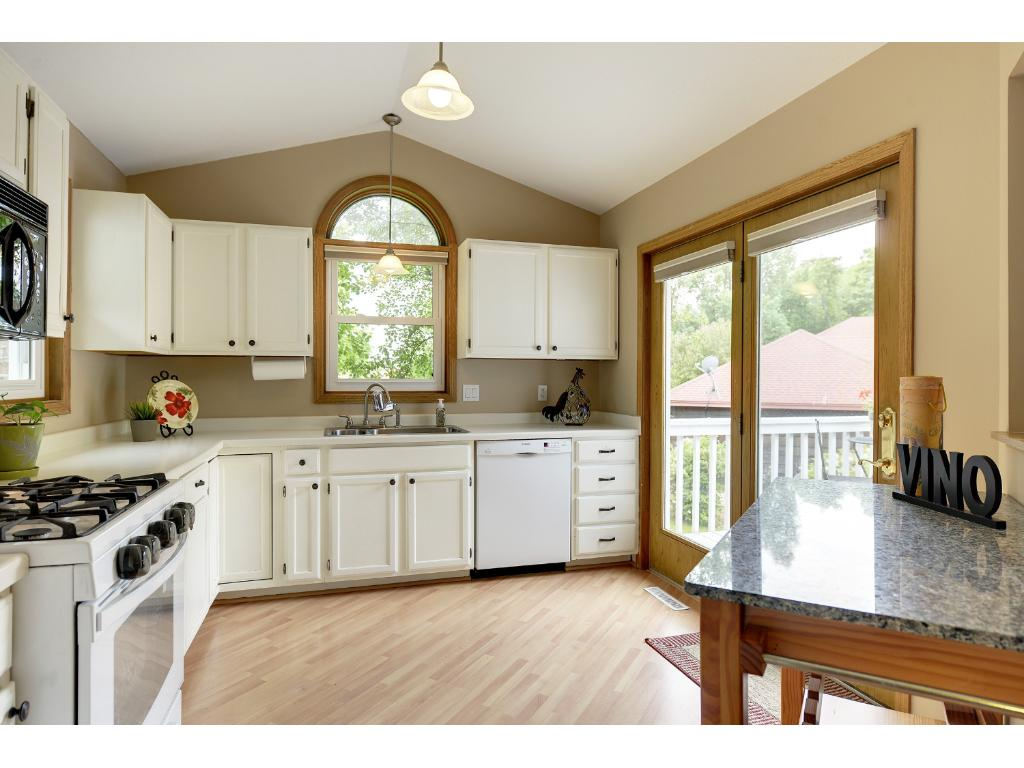 Natural light spills into the kitchen keeping it bright!  Patio door leads to large wrap around deck.