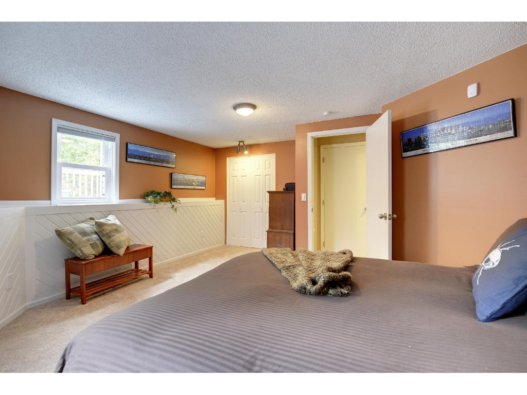 Another view of the HUGE lower level bedroom that looks out to the beautiful back yard.