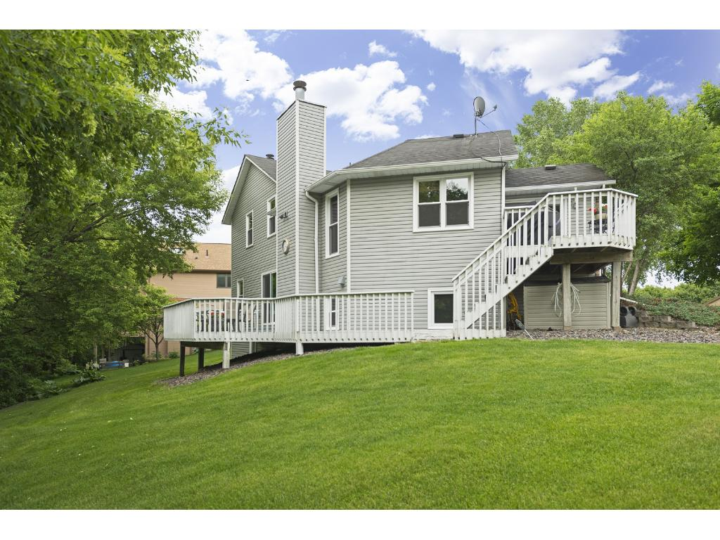 Amazing wrap around deck extends from the kitchen to the lower level family room.  A perfect place to enjoy this summer!