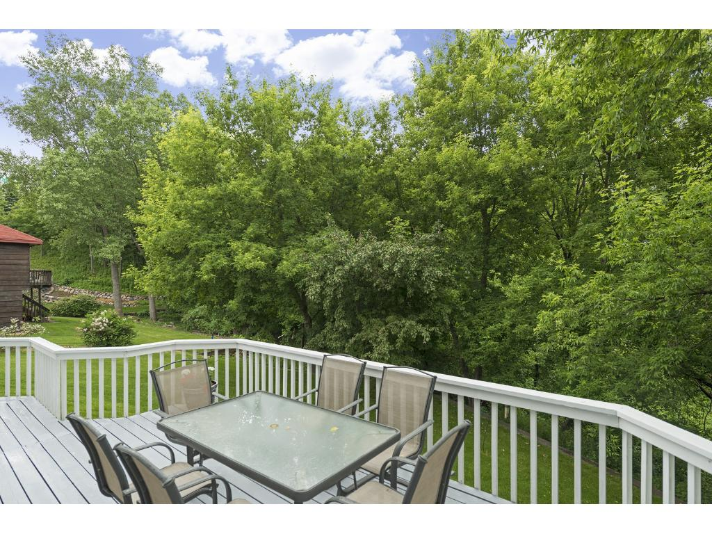 Mature tree lined backdrop adds privacy.