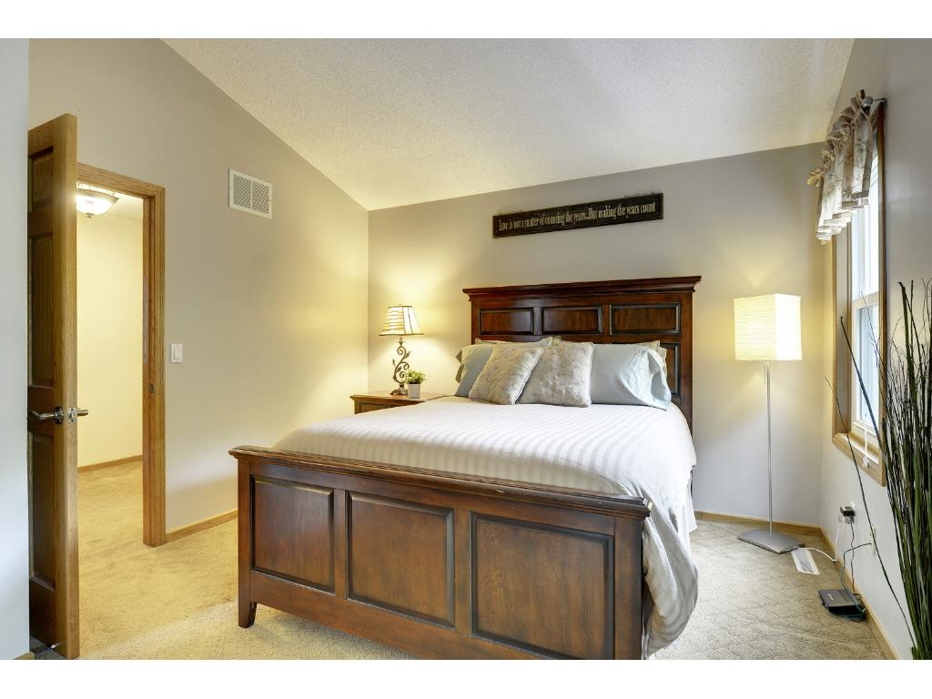 Master suite has vaulted ceiling, a walk-in closet, and an updated full bathroom.