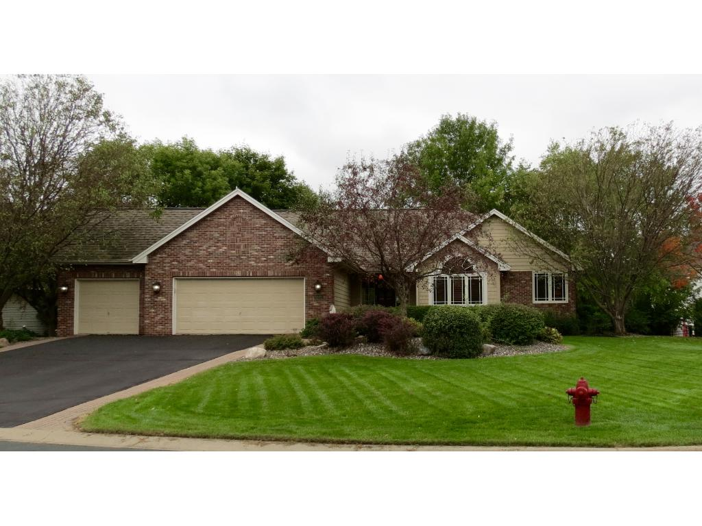 Beautiful corner lot with expansive front gardens and landscaping