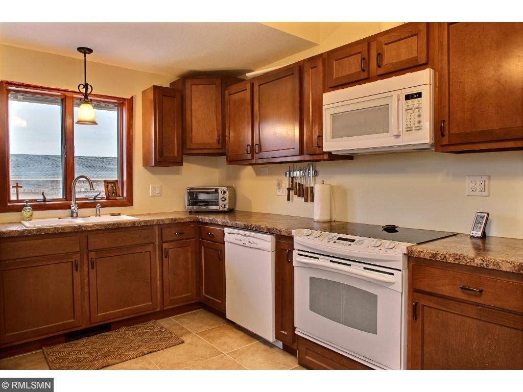 Enjoy the view from the kitchen window.  Faces the back yard and detached 3 car garage.  The cabinets are spacious and plentiful!