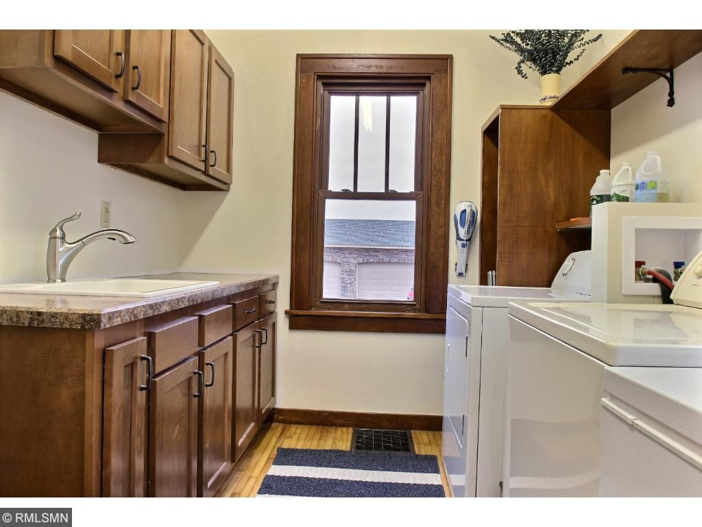 This home has been recently renovated to provide one level living.  The laundry room is conveniently located next to the kitchen and has lots of cabinets and a counter for folding.  A 1/4 bathroom is adjoining the laundry room.