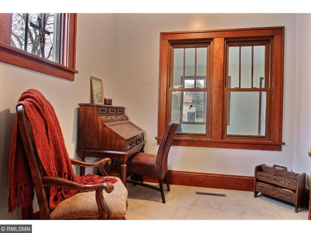 The master suite is located off the living room.  It is a private little get away for the home owners with a sitting area, private 3/4 bath and walk in closet.