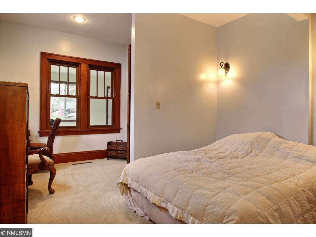 The beautiful, original woodwork continues to flow into the master bedroom.