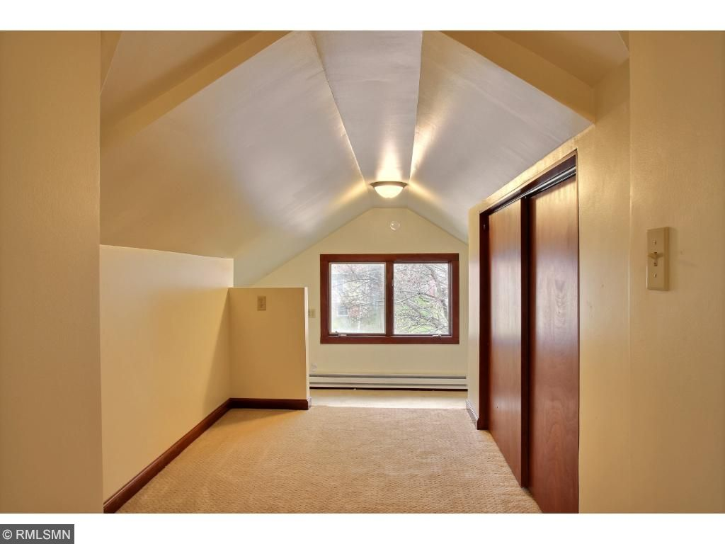 This is the third upper level bedroom and is fun and unique!  It has 2 levels and slanted ceilings, giving it a fun, creative feel.  Nice large closets and a window over looking the front yard!
