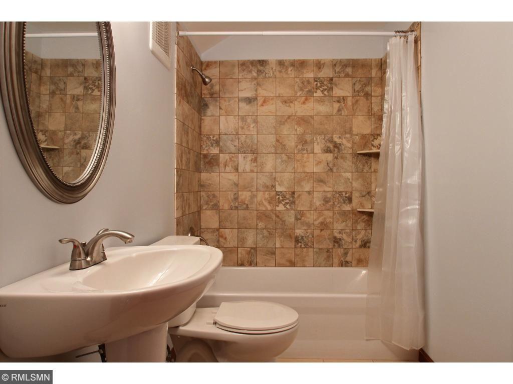 The upper level, full bathroom with tile shower.