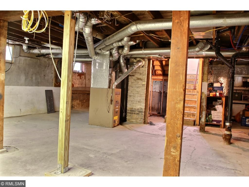 The unfinished, lower level is dry and offers plenty of room for storage.