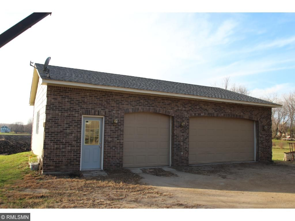 This extra large, detached 3 car garage has a beautiful brick front.  Extra room inside for a workshop!