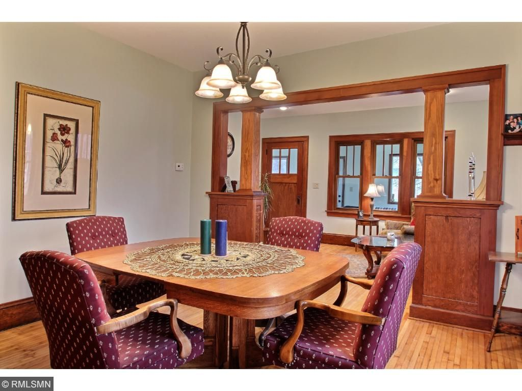 This picture taken in the dining room shows another side of the built in show case.  All the wood work is in great shape!  The dining room also boasts a large window and window box seating!