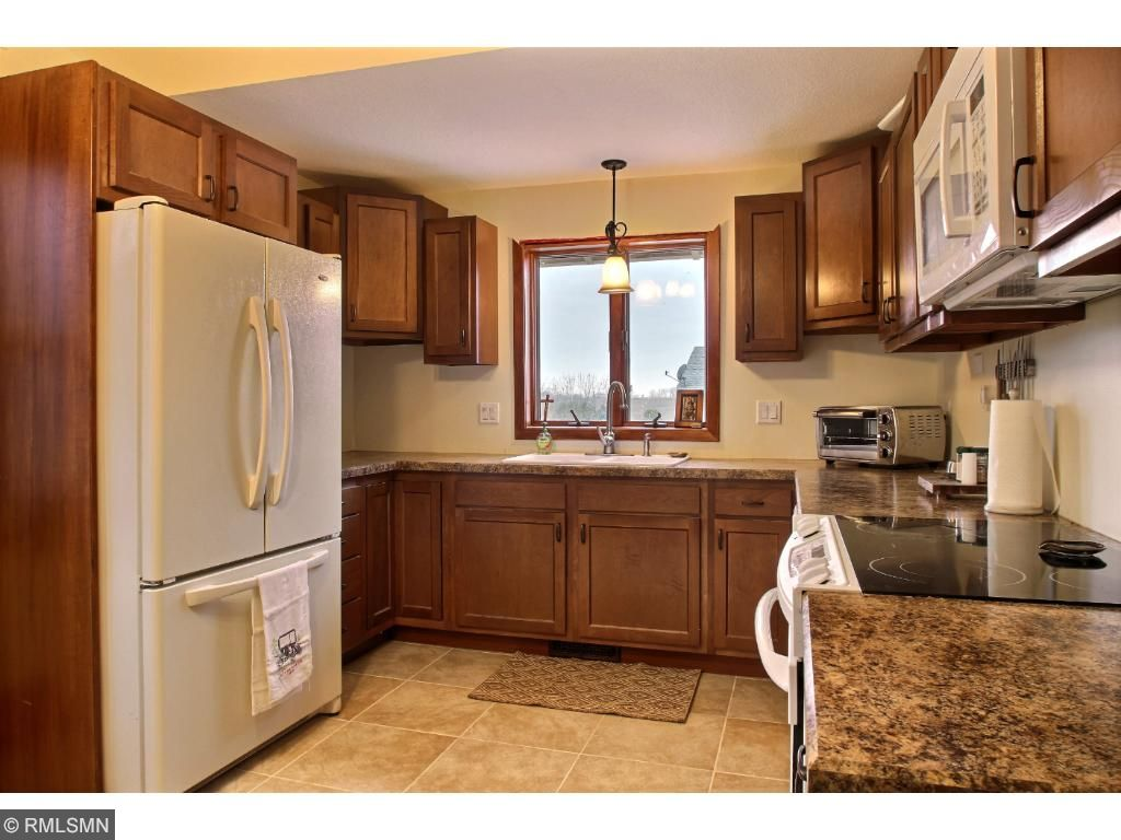 The kitchen is all new, from head to toe, with ceramic tiling cabinets, counter tops and appliances!  Nice layout with a great flow for cooking and baking!