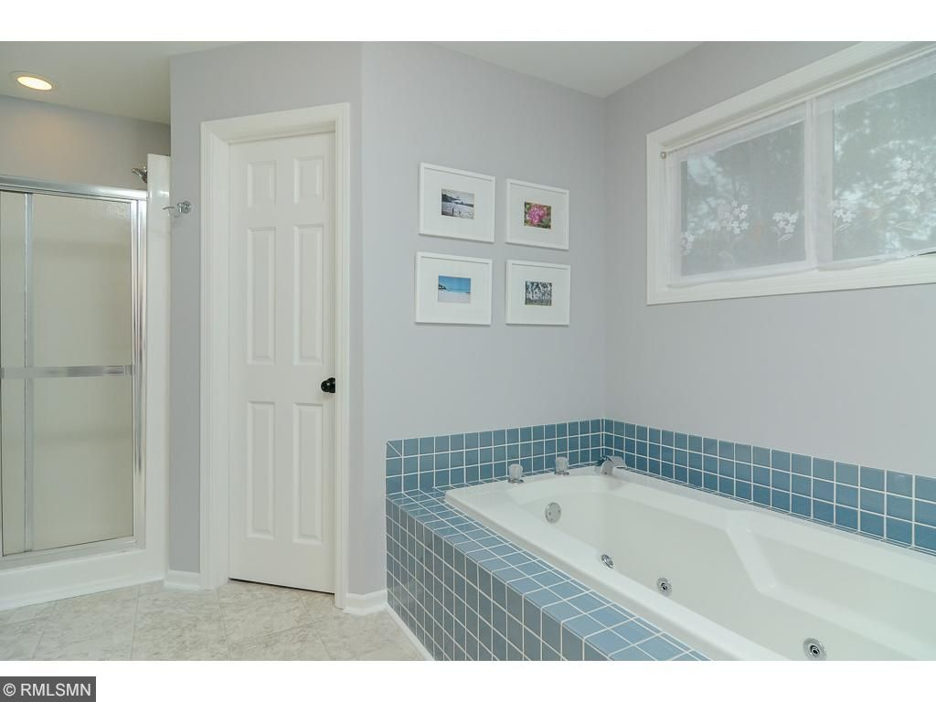 Tile, separate shower and two walk in closets complete the main floor master suite area