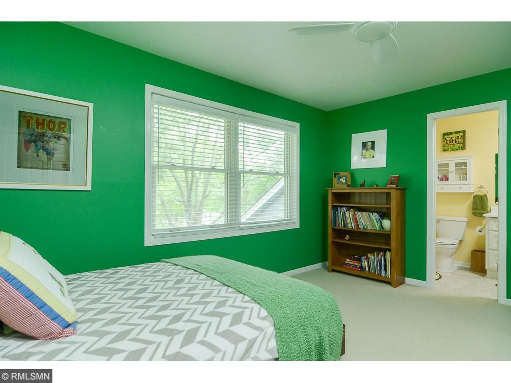 This second bedroom has access to the upper level hall bathroom