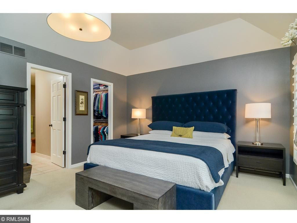 Another shot of the upper level master bedroom with two walk in closets