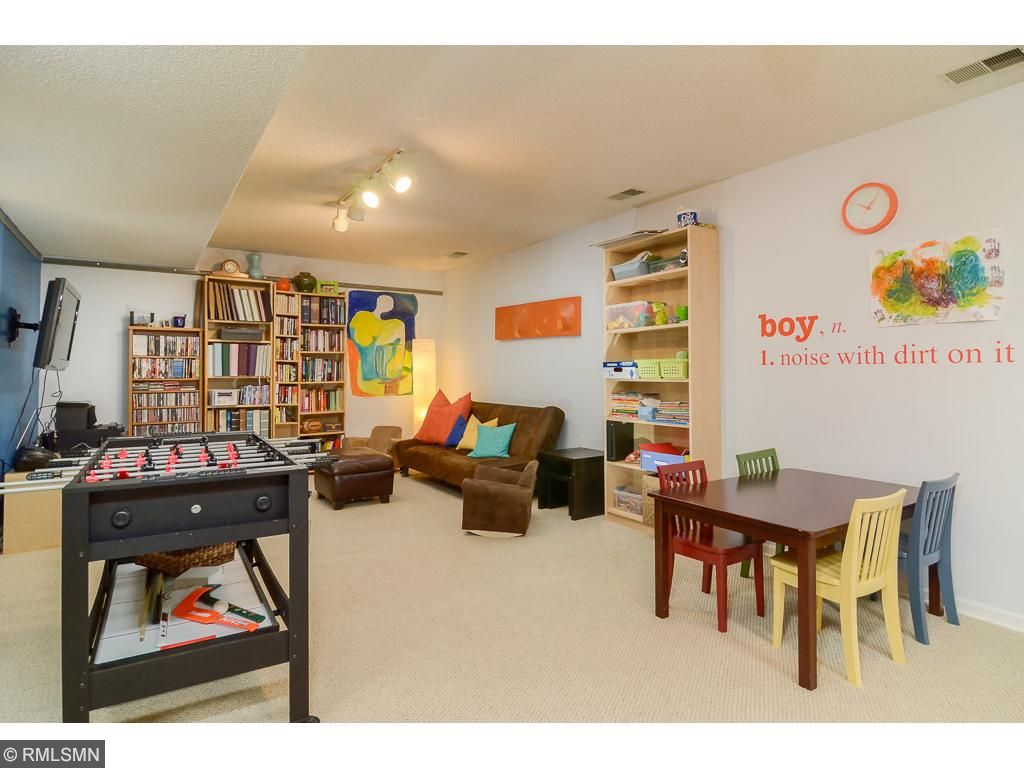 Many entertaining and play hours have been spent in this brightly lit lower level family room