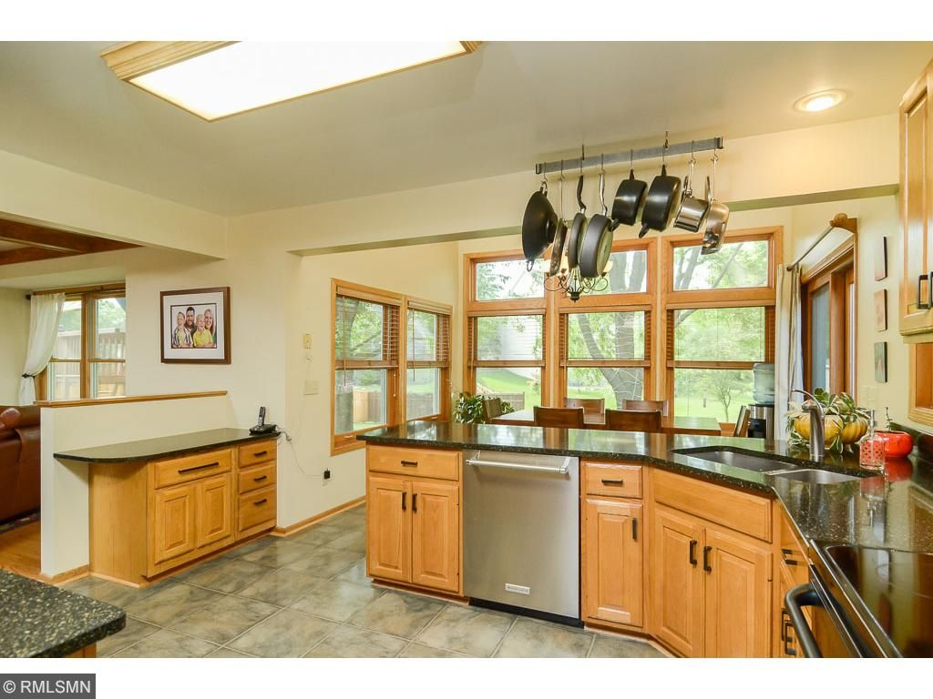 A spacious and well appointed kitchen features new appliances and granite countertops