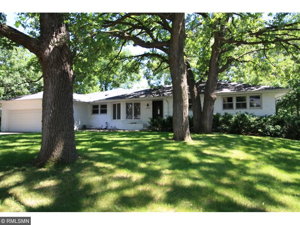 Large walk-out ranch style home on idyllic site next to Minneapolis Golf Course in St Louis Park