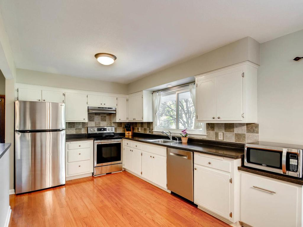 Kitchen has been remodeled, new appliances added and great window looking out into the backyard