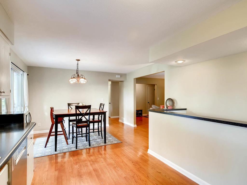 Kitchen is open to the dining area and has patio door walking out to the maintenance free deck.