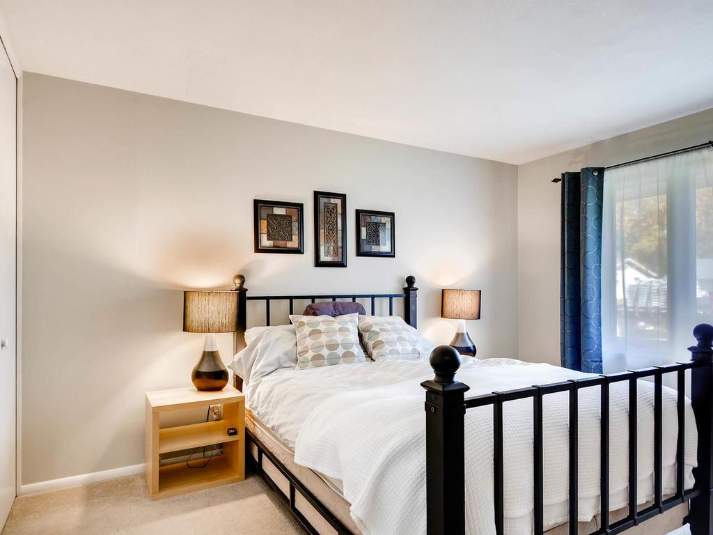 Master bedroom has his and her closets with organizers.