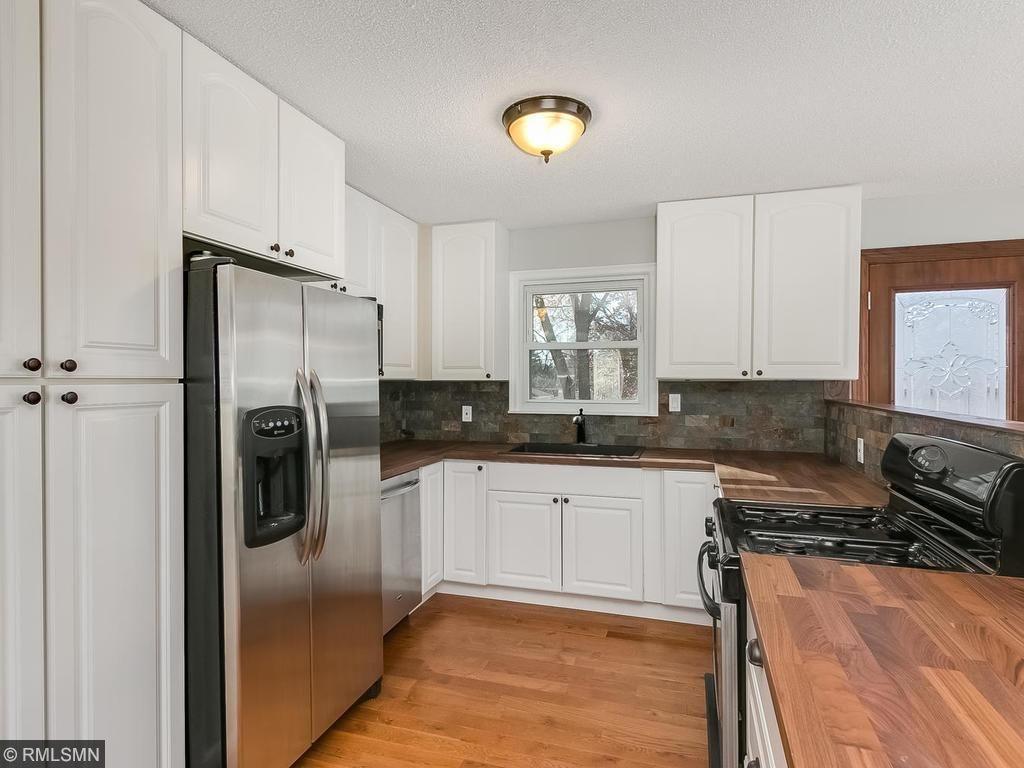 Brand new kitchen with slate backsplash