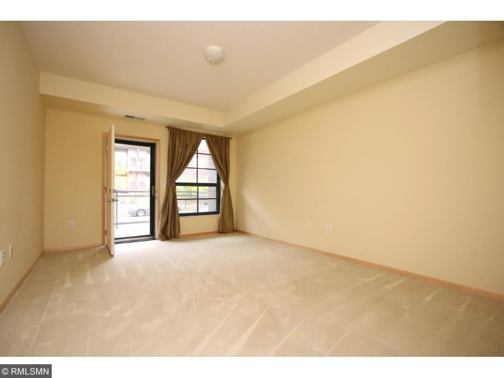 Spacious master bedroom features private back patio