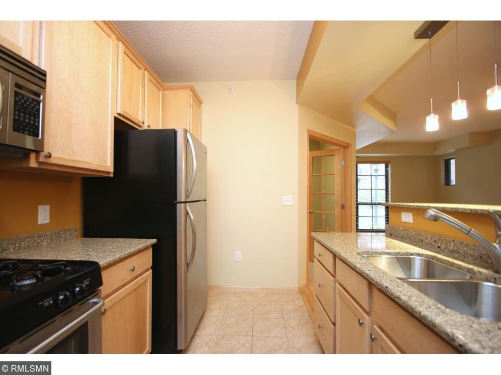 Quartz counter tops, stainless appliances and plenty of cabinet space